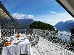A private balcony ideal for sunbathing and furnished with outdoor dining table & chairs