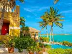 Beachfront Three Cays Villa, gated with lush gardens, natural sea reefs & pool