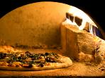 Sample delicious, fresh home-made pizza's baked in stone pizza ovens as part of your stay.