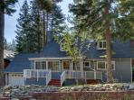 This luxurious Tahoe home is surrounded by tall pine trees.