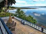 Expansive unobstructed panoramic view deck with connecting beach stairs