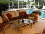 Large Lanai with outdoor gas grill and heated pool