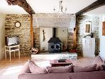 Le Clos - The Lounge with woodburner and wood provided for those cosy evenings
