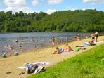 The beach at peaceful Lac Bourg D'Hem, ideal for children