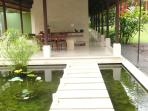 Water feature from open pavilion to dining area