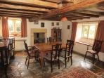 Dining room with beams and flagstone floors