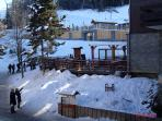 Winter view from balcony up to ski lifts
