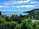 View over towards Tasman Bay from house with tide going out