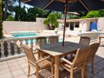 Terrace with heated pool, bbq,outdoor kitchen and table tennis table.