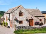 THE COW BARN, woodburning stove, feature beams and stone floors, WiFi, ground floor accommodation, patio with furniture, Ref 24191