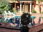 appartment swimming pool with sun loungers