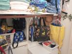 Second Bath Dressing Area Closet with Sports Gear, Dresser, Towels, Laundry Supplies
