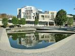 Scottish Parliament, just a short walk away and opposite Holyrood Palace