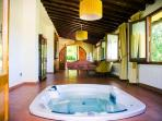 The main lounge with jacuzzi. It opens onto the rear patio with scenic views of the valley.
