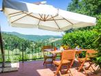 The rear patio with view of the valley. Enjoy the sunset with a complimentary glass of Prosecco!