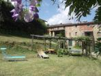 general view of the garden and the house set in the lush nature