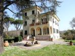 Elegant four bedroom Tuscan villa in peaceful countryside setting with private gardens and chef