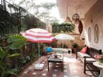 Garden - the lounge area. Teak bench and table, exotic lanterns. Beautiful when it's warm