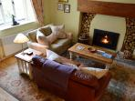 The spacious yet cosy living room with woodburner
