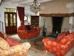 The comfortable sitting room with its massive fireplace