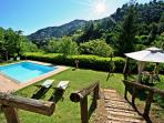 Attractive, secluded farmhouse on a Tuscan hillside featuring lovely pool, private garden and barbecue