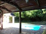 View from pergola to pool and garden