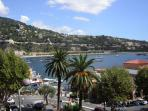 View of the centre of old Villefranche and the beach behind