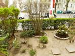 There is a small garden in front of the building