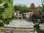 Plenty of space to bbq on pretty terrace overlooking garden and surrounding fields.