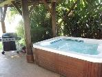 Relax in jacuzzi outside with garden views