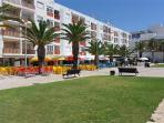 Open piazza with cafes and restaurants in Fuzeta