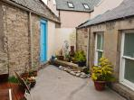 Courtyard garden - with blue door giving access to secure storage.