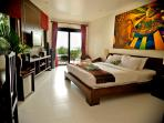 Room Lily with a Kingbed, large bathroom with jacuzzi and private patio Downstairs