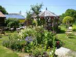 The lovely garden, just relax & enjoy. Lots of places to sit & enjoy lunch with a glass of wine.