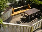 Sunny, private garden with hand-made oak bench, table and seating. The Apple tree may provide snacks