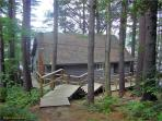 Waterfront Log Cabin style home on Thompson Lake!