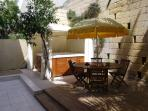 Dining area and jacuzzi spa with zip-up winter gazebo