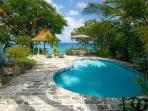 Secluded Senderlea sits cliffside with stairway beach access & tropical pool