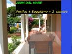 2 bedroom Tuscany holiday apartment rental with lovely garden and porch located just steps from the beach