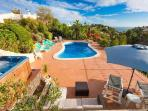 Beautiful pool, sun terrace and hot tub with stunning view across the valley and out to sea
