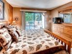 Master bedroom with a king sized bed.