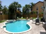 Beautiful beach area pool house 1 block from beach