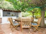 Dining for 8 by the summer kitchen and the pool, shaded by the mulberry tree