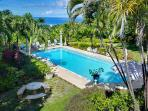 Essential 4 bedroom 1 storey villa, set amongst tropical plants and boasts a large swimming pool with a sun bathing patio