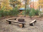Fire pit gathering space in the woods.  Outdoor enjoyment at its finest.
