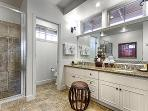 Master bath with double sinks, granite counter, walk-in shower and large mirror
