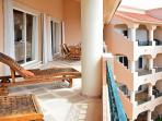 Quinta del Sol condo Mayan Waters - large terrace with dining and lounge areas