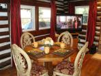 Dining Table by windows overlooking the covered front porch, 50' HDTV/DVD/Surround Sound