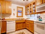 This full kitchen has all you'll ever need to whip up something delicious.