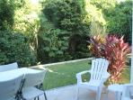 Secluded rear patio with only plants and trees before the golf course